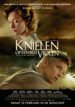 Knielen op een bed violen (2016)